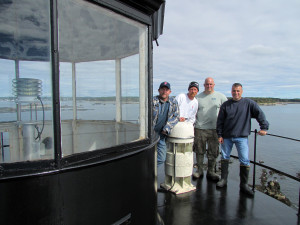 L to R: Jim Leslie, Brian Johnson, and Kyle Brant of the J.B. Leslie Company, and Bob Trapani, Jr., executive director of the American Lighthouse Foundation.