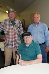Former Coast Guard lighthouse keepers Jim Pope (left), Fred Mikkelsen, and Russ Lane (seated). Photo by Bob Trapani Jr.